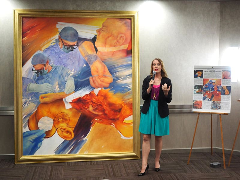 Taryn explains her artwork to family, friends and colleagues.