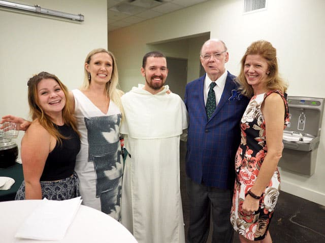 Guests at both ends of our little group join me, along withMadelaine Kuns Brushini, Director of Development at Tulane Catholic Center, and Fr. Thomas Schegden, Chaplain of the Tulane Catholic Center, to enjoy this stellar event.