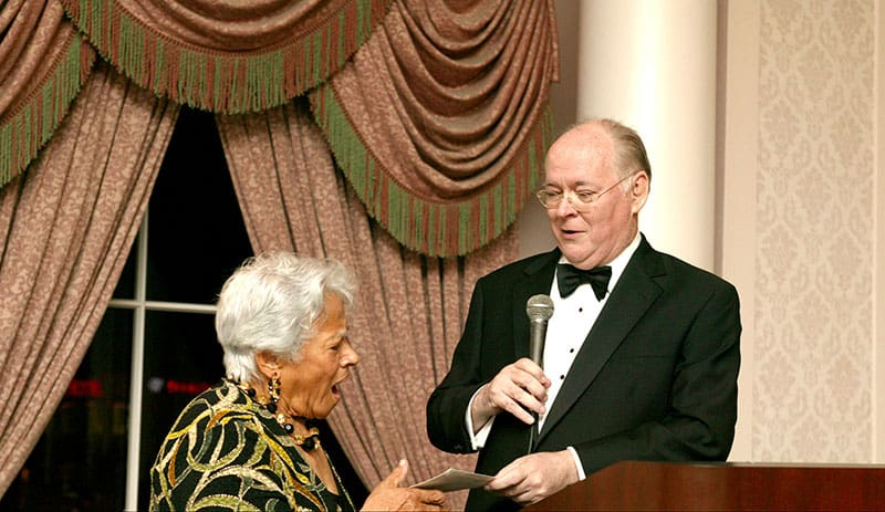 Me surprising Leah Chase with a $25,0000 personal contribution check for her continued recovery from the devastating effects of Hurricane Katrina on her family-owned restaurant, Dooky Chase, at the Southern Dominican Gala 2007.
