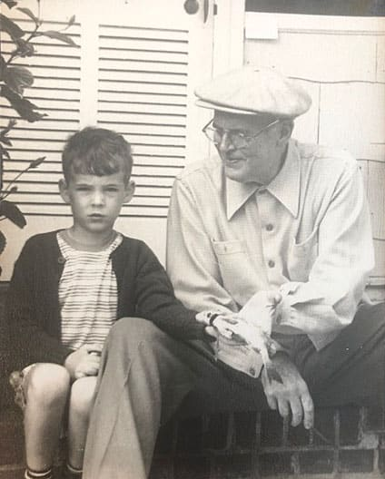With grandpa, Joseph T. Lykes, in Clearwater, Florida after I caught my first fish, which was a flounder. Grandpa was very pleased, while I looked quite serious. I will never forget this picture or this day, 1948.