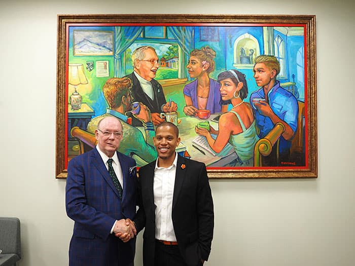 Me and Terrance Osborne in front of the Fr. Val Ambrose McInnis art piece I commissioned and gifted to the Fr. Val A. McInnis, O.P. Tulane Catholic Center.