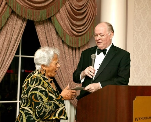 Richard surprising Leah Chase with a $25,0000 personal contribution check for her continued recovery from the devastating effects of Hurricane Katrina on her family-owned restaurant, Dooky Chase at the Southern Dominican Gala 2007.