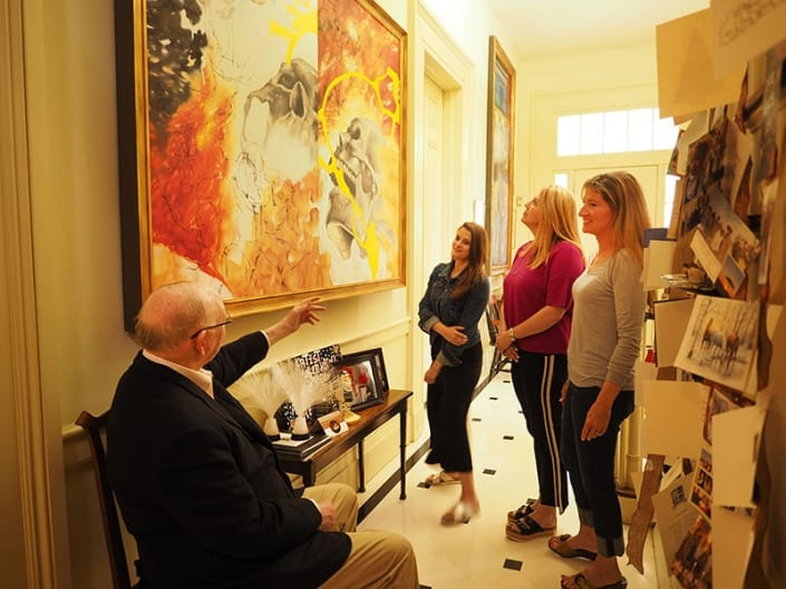 Me, Lauren Selden, Susan Badeaux, and Sherrie Soule study the original diptych painting by Taryn M. Nicoll. This surgery, by Dr. Stephen Metzinger, is the only one for which Taryn was not in the operating room.