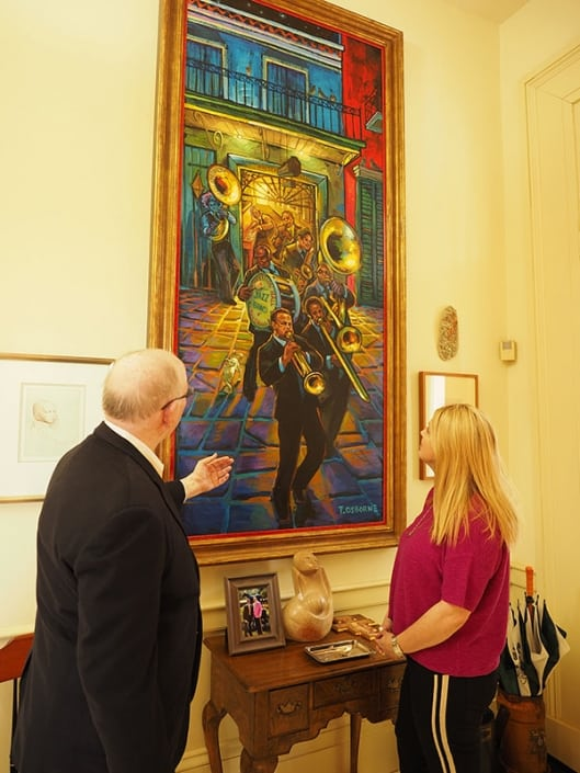 Susan Badeaux and I look at Terrance Osborne's original 2014 New Orleans Jazz Festival painting of the Preservation Hall & The Preservation Hall Jazz Band.